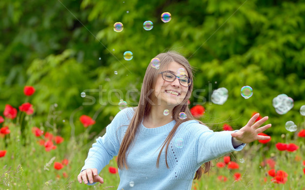 Girl Catching Soap Bubbles Stock photo © mady70