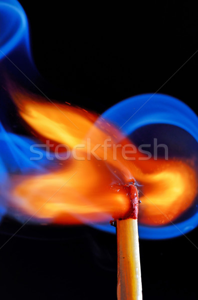 lighting a match on black background Stock photo © mady70