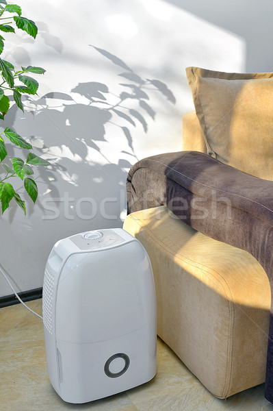 Stock photo: Portable dehumidifier colect water from air