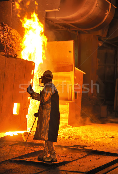A steel worker takes a sample from oven Stock photo © mady70