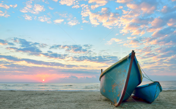 sunrise over an  wooden fishing boats Stock photo © mady70