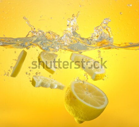 lemon thrown into the water with splash Stock photo © mady70