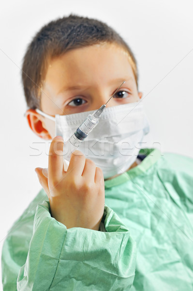 Boy in uniform giving injection  Stock photo © mady70