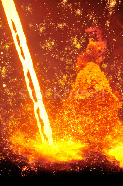 Molten hot steel pouring Stock photo © mady70