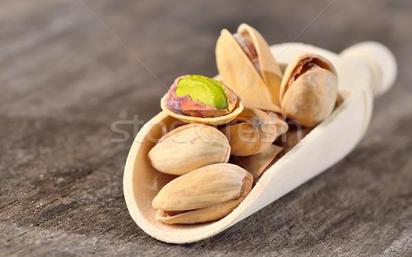 Crudo pistacho nueces cuchara de madera edad Foto stock © mady70