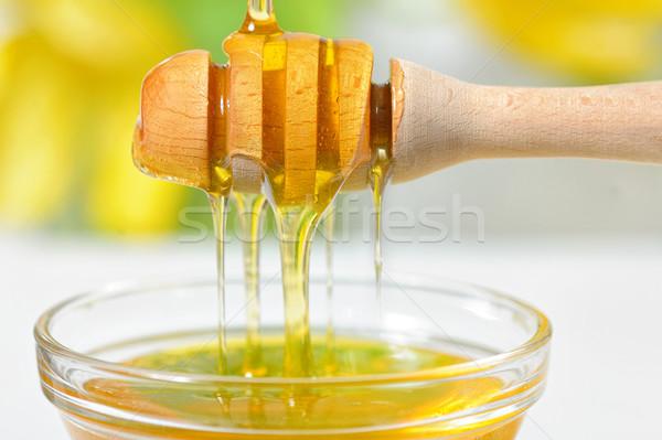 Golden honey dripping Stock photo © mady70