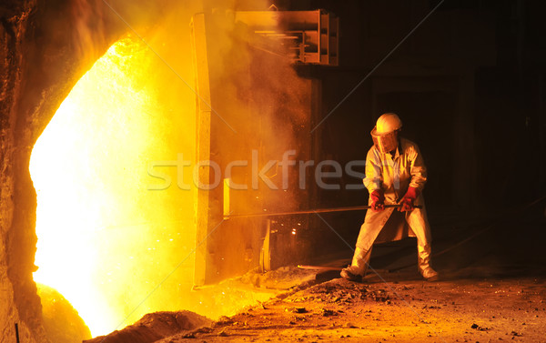 worker takes a sample at steel company  Stock photo © mady70