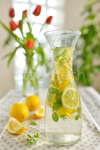 Stock photo: Fresh limes and lemonade