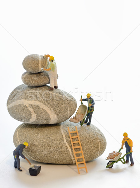 Pebbles stack and figurines of construction workers Stock photo © mady70