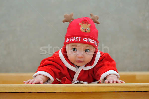 A baby in a Santa suit  Stock photo © mady70