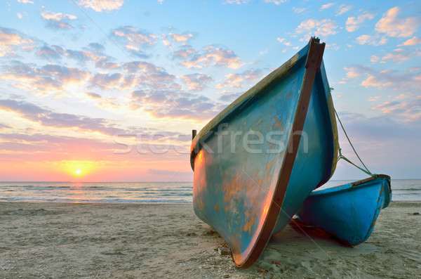 Sunrise over an two wooden fishing boats Stock photo © mady70