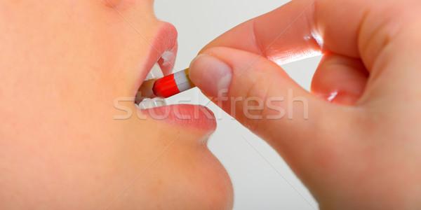 Woman taking pills Stock photo © mady70