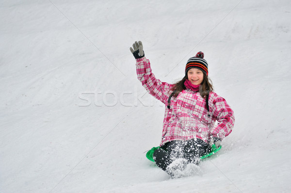 girl sliding in the snow Stock photo © mady70