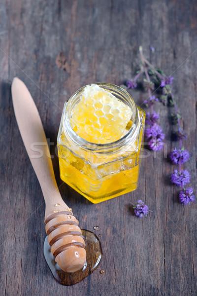Plaster miodu miodu szkła jar mięty Zdjęcia stock © mady70