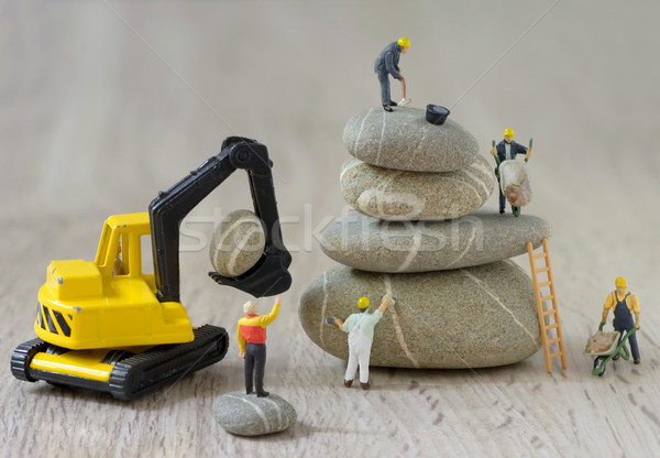 Cailloux travailleurs construction bâtiment design Photo stock © mady70