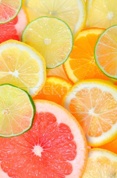 Sliced citrus fruits background Stock photo © mady70