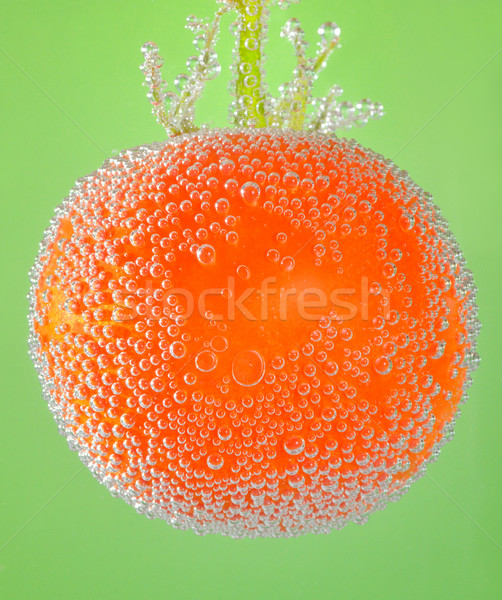 tomato immersed in mineral water Stock photo © mady70