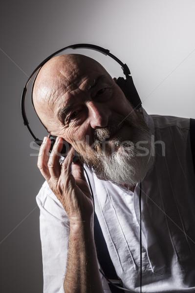 Viejo escuchar música imagen música hombre luz Foto stock © magann