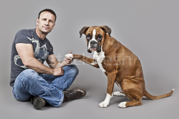 handsome muscle man with his dog Stock photo © magann