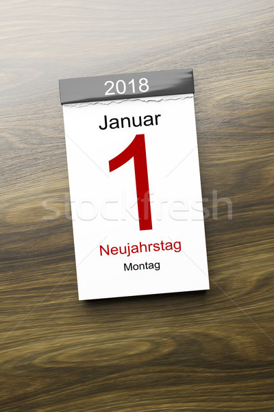 a calendar the 1st of January new year day text in german langua Stock photo © magann