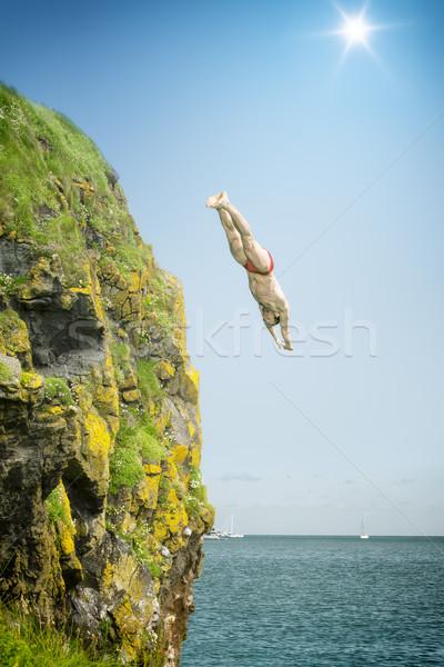 cliff jumper Stock photo © magann