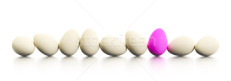 a row of easter eggs one dyed in pink Stock photo © magann
