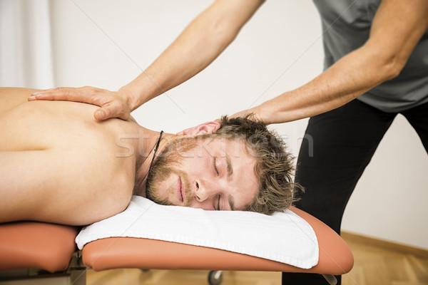 Jeune homme thérapie image homme santé massage Photo stock © magann