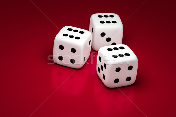 three white dice on a red background Stock photo © magann