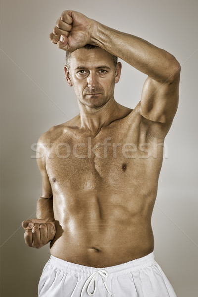 Orta yaş taekwondo savaşçı temel pozisyon Stok fotoğraf © magann