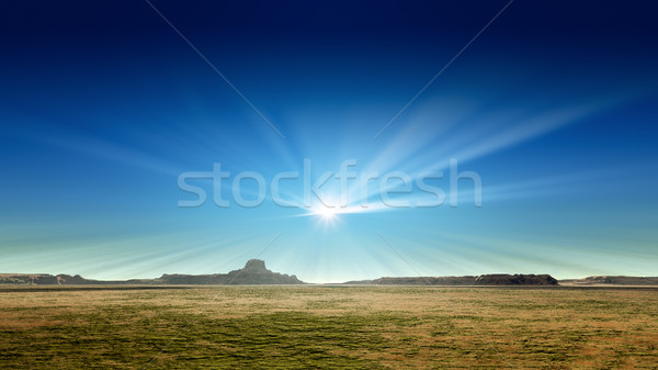 a desert scenery with sun rays in the blue sky Stock photo © magann
