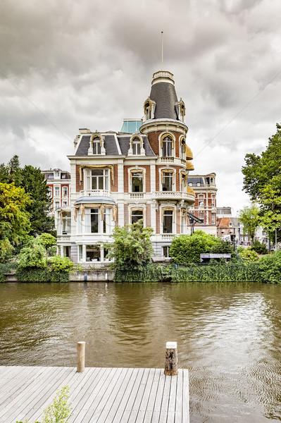 Mooie huis Amsterdam afbeelding water wolken Stockfoto © magann