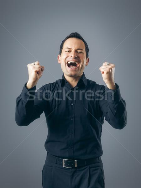 Férfi nyertes póz kép üzlet kéz Stock fotó © magann