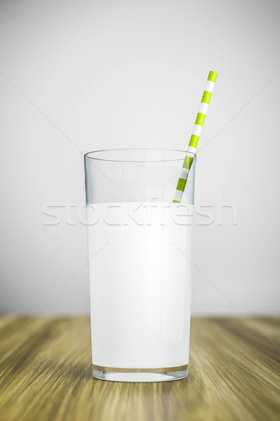 a glass of milk with a green straw Stock photo © magann