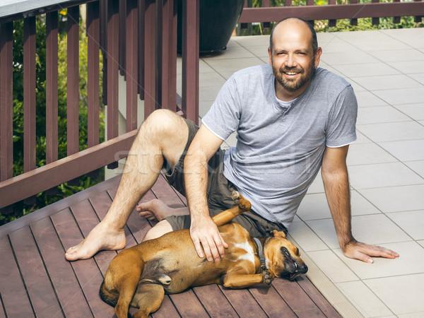 Foto stock: Homem · cão · imagem · amor · grama · jardim