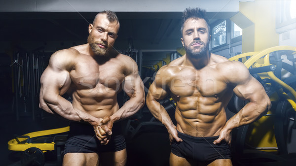 two male bodybuilder posing at the gym Stock photo © magann