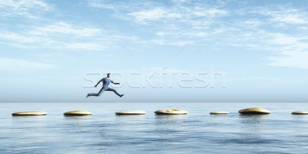 Jumping immagine uomo pietra spiaggia natura Foto d'archivio © magann