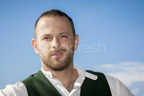 Tradição homem retrato imagem céu nuvens Foto stock © magann