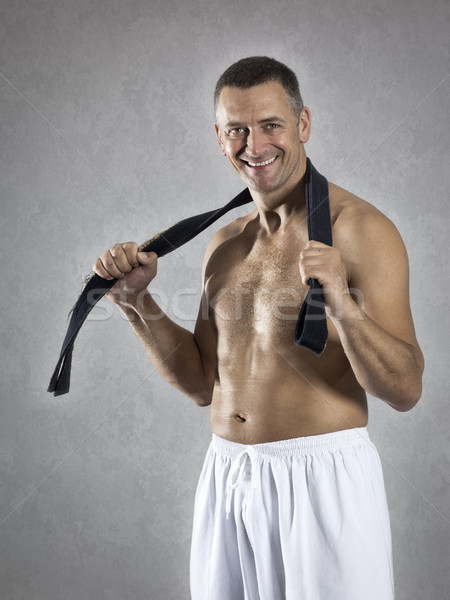 middle age martial arts sports man with a black belt Stock photo © magann
