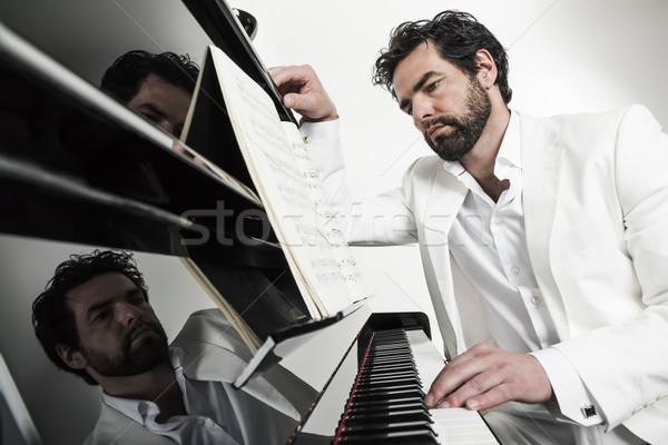 Stock photo: man with piano