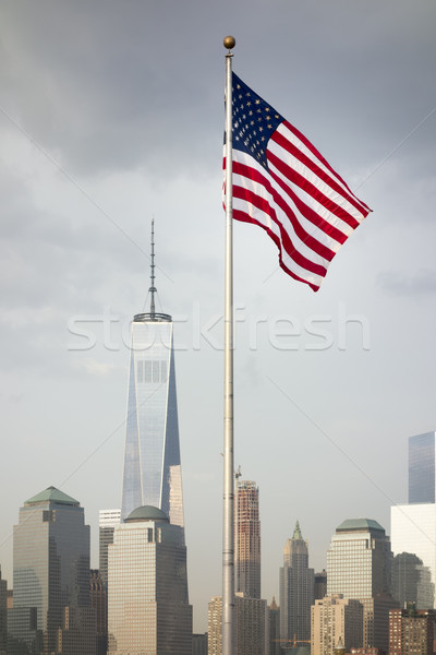 the flag of the United States in front of the skyscrapers in New York Stock photo © magann