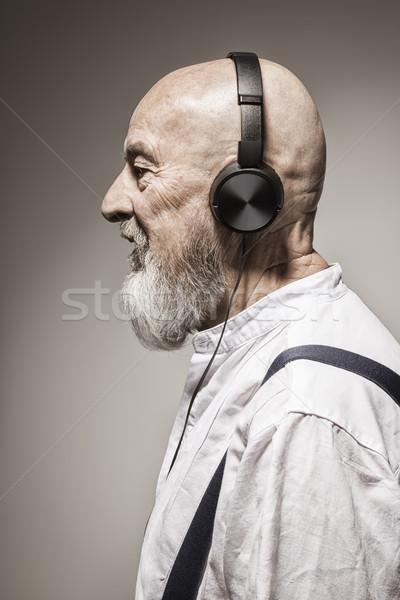 Ouderen kaal hoofd man hoofdtelefoon afbeelding Stockfoto © magann