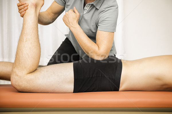 young man at the physio therapy Stock photo © magann