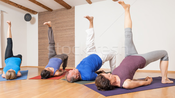 Yoga Exercise - Eka Pada Setu Bandha Sarvangasana  Stock photo © magann