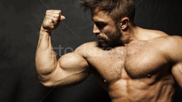 A muscular man flexing his biceps Stock photo © magann