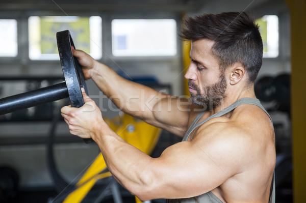 Masculino musculação peso imagem esportes fundo Foto stock © magann