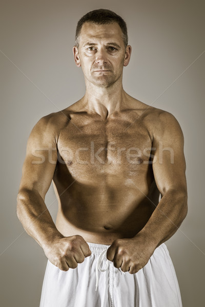a middle age taekwondo fighter in basic position Stock photo © magann
