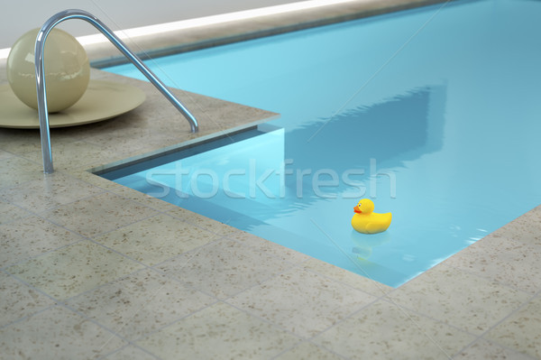 yellow rubber duck in an indoor pool Stock photo © magann