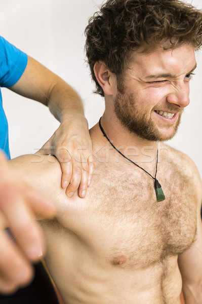young man at the physio therapy with pain Stock photo © magann