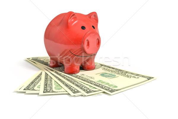 a red piggy bank over dollar notes Stock photo © magann