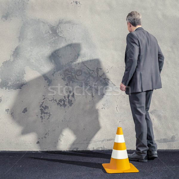 a business man facing a dirty wall Stock photo © magann